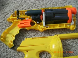 1)the first step in painting a Nerf gun is to pull it apart so you can see  the